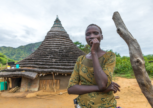 Larim tribe woman in front of her traditional house, Boya Mountains, Imatong, South Sudan