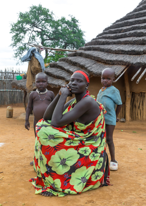 Larim tribe woman with her children in front of her traditional house, Boya Mountains, Imatong, South Sudan