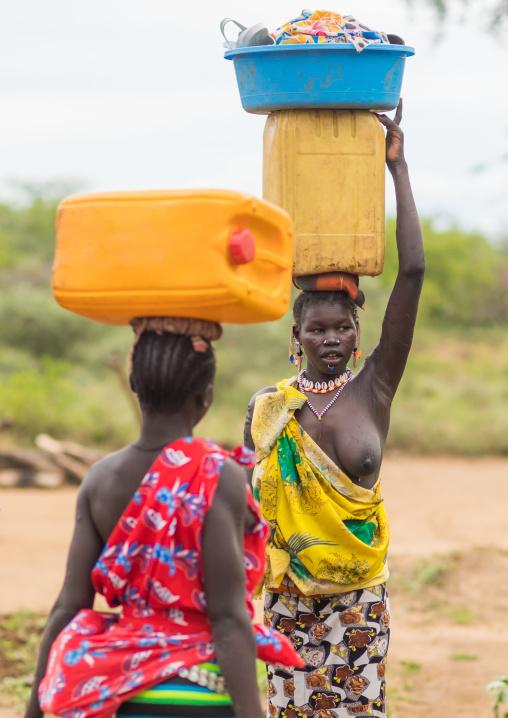 Portrait of a Larim tribe women carrying a yellow jerrican on the heads, Boya Mountains, Imatong, South Sudan