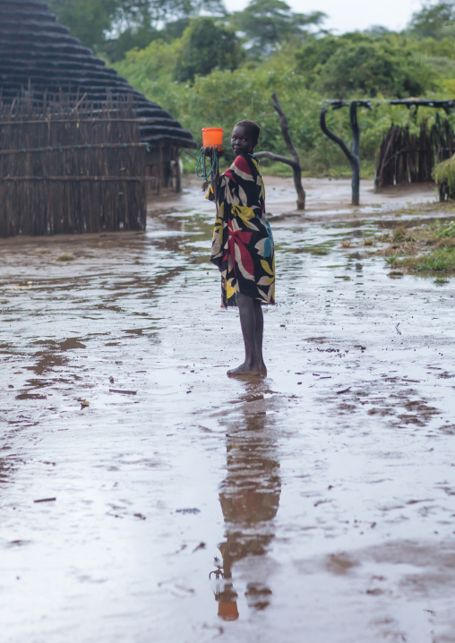 Larim tribe girl under the rain in a village, Boya Mountains, Imatong, South Sudan