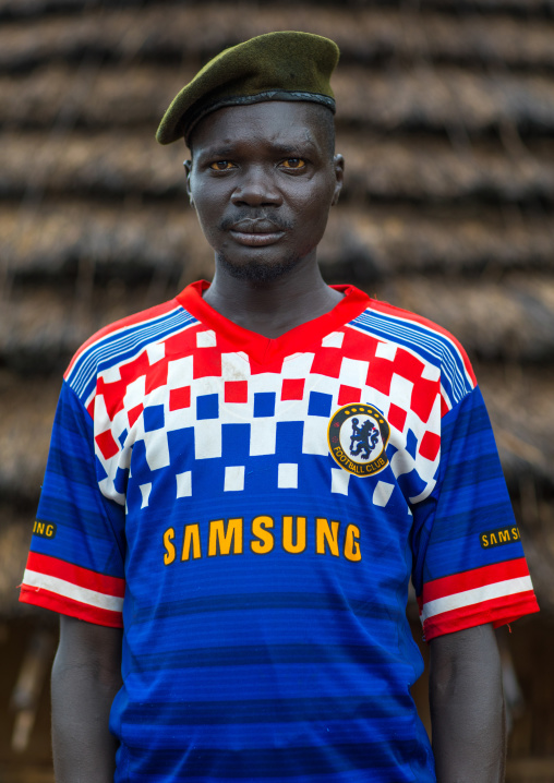 Portrait of a former soldier from Larim tribe wearing a chelsea football shirt, Boya Mountains, Imatong, South Sudan