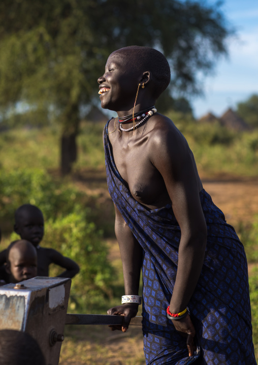 Mundari tribe woman pumping water in a well, Central Equatoria, Terekeka, South Sudan