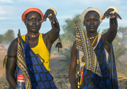 Mundari tribe women mimic the position of horns of their favourite cows, Central Equatoria, Terekeka, South Sudan