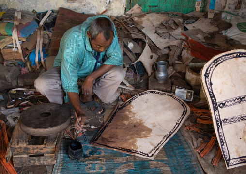 Sudanese man working on leather in the market, Kassala State, Kassala, Sudan