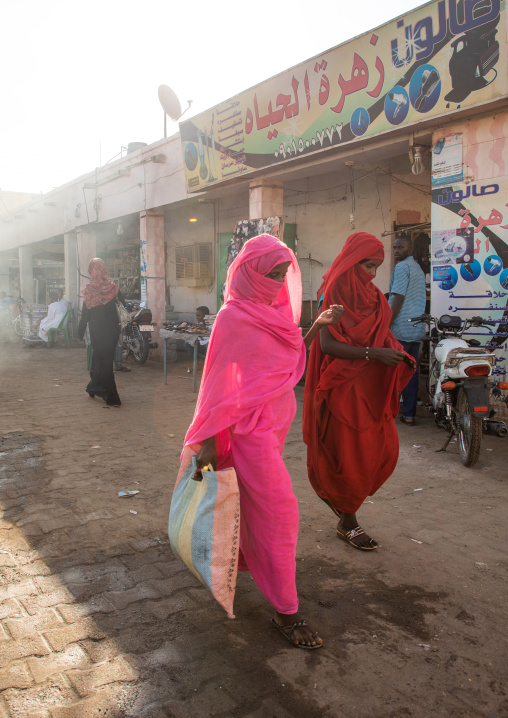 Sudanese women walking in the street in colorful clothes, Kassala State, Kassala, Sudan