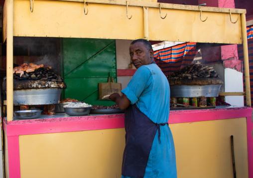 Chicken meat cooked on heated stones, Kassala State, Kassala, Sudan