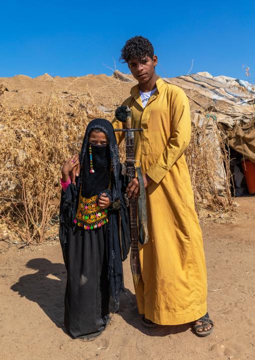 Portrait of Rashaida tribe teenage boy and girl in traditional clothing, Kassala State, Kassala, Sudan