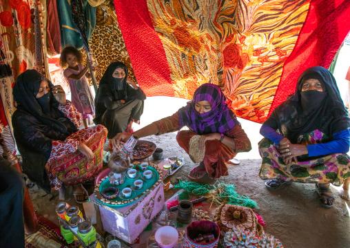 Rashaida tribe women inside their tent making coffee, Kassala State, Kassala, Sudan