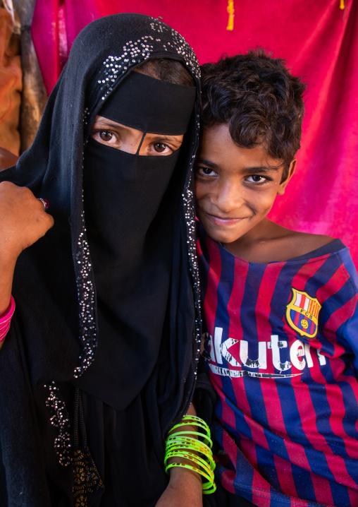 Rashaida veiled girl and a boy wearing a Barcelona football shirt, Kassala State, Kassala, Sudan