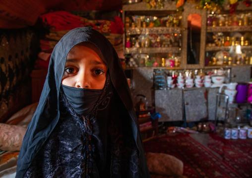 Portrait of Rashaida tribe veiled girl inside her house, Kassala State, Kassala, Sudan