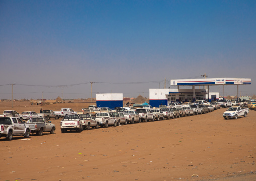 Sudanese people in their cars queue on line at a gas station during the fuel shortages, Kassala State, Kassala, Sudan