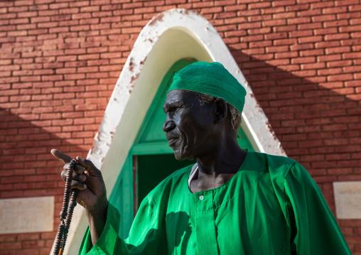 Sufi dervish in green clothes, Al Jazirah, Abu Haraz, Sudan