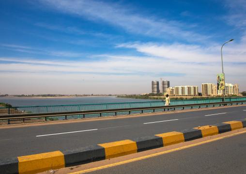 Sudanese man crossing a bridge over river Nile, Khartoum State, Khartoum, Sudan