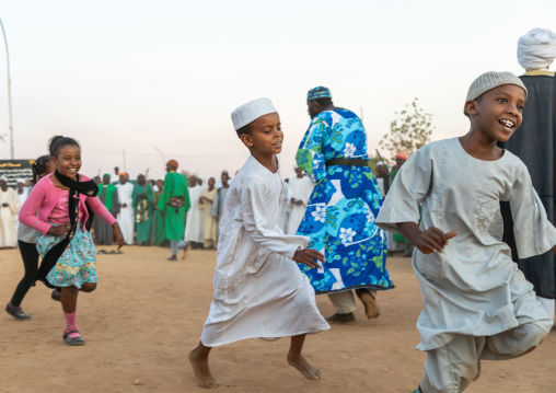 Children running during the friday sufi celebration at sheikh Hamad el nil tomb, Khartoum State, Omdurman, Sudan
