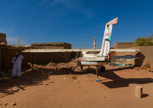 Old propeller airplane parked in a village, Khartoum State, Omdurman, Sudan