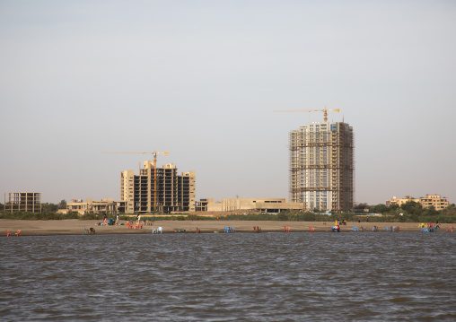 Cranes on a construction site on the bansk of river Nile, Khartoum State, Khartoum, Sudan