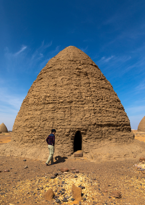 Tourists in front of a beehive tomb, Nubia, Old Dongola, Sudan