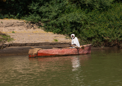 Fisherman in a boat on river Nile, Northern State, El-Kurru, Sudan