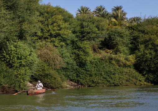 Fisherman in a boat on river Nile, Northern State, El-Kurru, Sudan