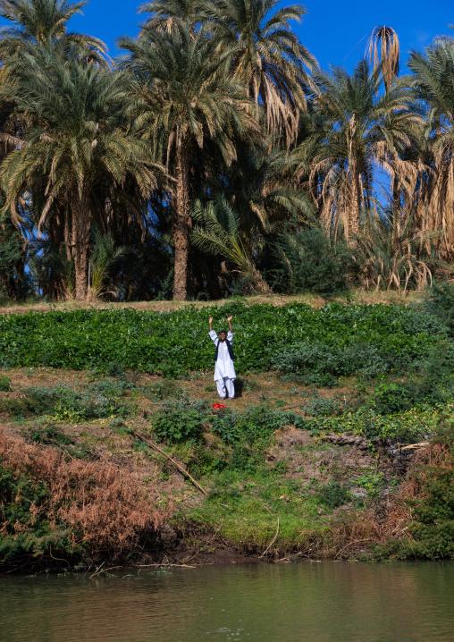 Sudanese man gardening on the bank of river Nile, Northern State, El-Kurru, Sudan