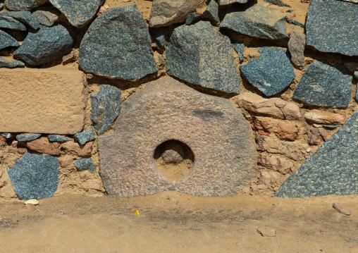 Millstone in a wall of al Ghazali christian monastery, Northern State, Wadi Abu Dom, Sudan