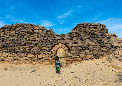 Sudanese child in gate in al Ghazali christian monastery, Northern State, Wadi Abu Dom, Sudan