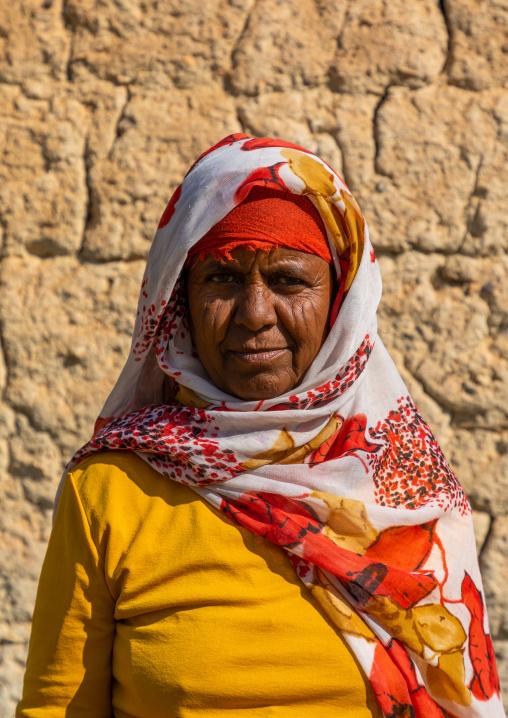 Bisharin nomad woman collecting salt in Atrun crater, Bayuda desert, Atrun, Sudan