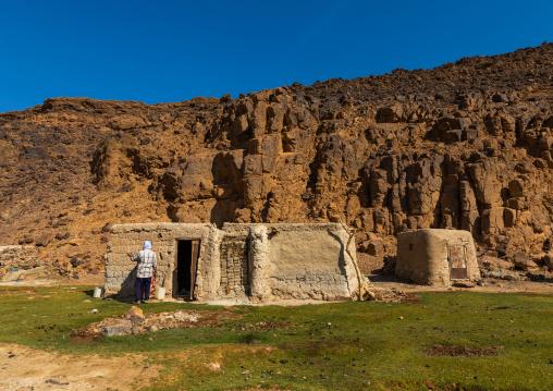 Bisharin nomad collecting salt in Atrun crater, Bayuda desert, Atrun, Sudan