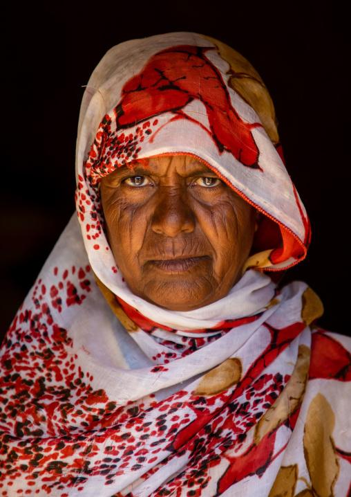 Portrait of a bisharin nomad woman Atrun crater, Bayuda desert, Atrun, Sudan