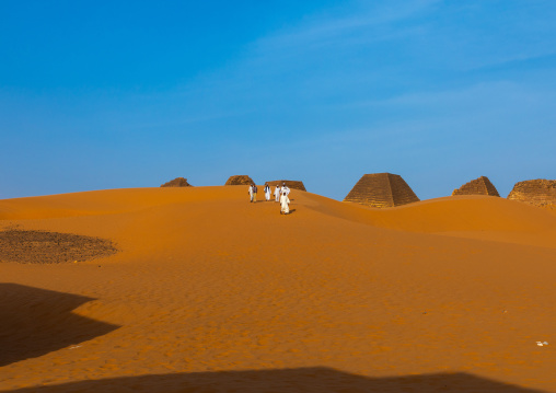 Sudanese tourists visiting the pyramids of the kushite rulers at Meroe, Northern State, Meroe, Sudan