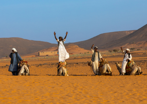 Sudanese men and their camels in Meroe, Northern State, Meroe, Sudan