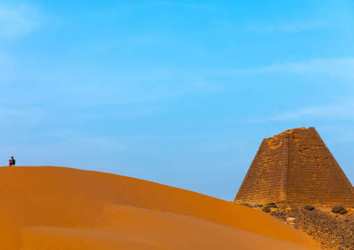 Tourist visiting the pyramids of the kushite rulers at Meroe, Northern State, Meroe, Sudan