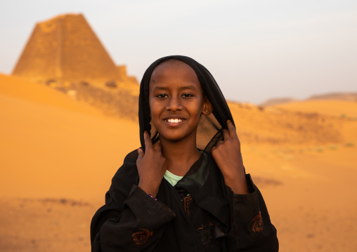 Portrait of sudanese girl visiting the pyramids of the kushite rulers at Meroe, Northern State, Meroe, Sudan