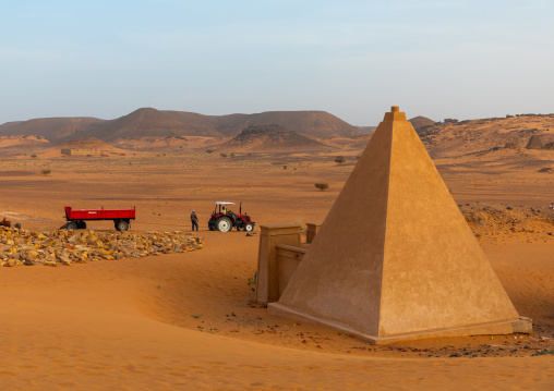 Workers making renovation in the reconstructed pyramids of the kushite rulers at Meroe, Northern State, Meroe, Sudan