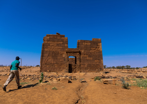 Sudanese man going to the lion temple of Apedemak, Nubia, Naqa, Sudan