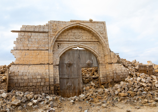 Wooden door in the middle of a ruined ottoman coral building, Red Sea State, Suakin, Sudan