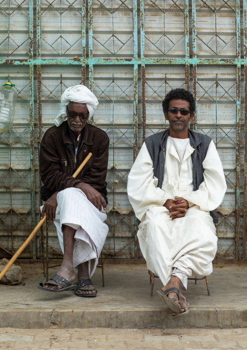Portrait of Beja tribe men sit in the street, Red Sea State, Port Sudan, Sudan
