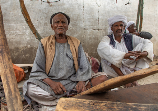 Portrait of Beja tribe men selling swords in the market, Red Sea State, Port Sudan, Sudan