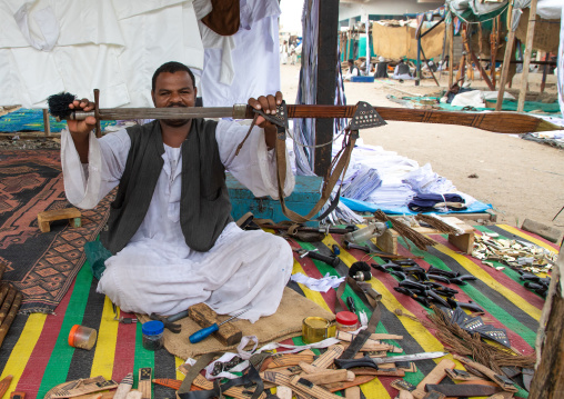 Portrait of a Beja tribe man selling sword in the market, Red Sea State, Port Sudan, Sudan
