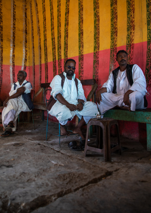 Beja tribe men drinking coffee in a bar, Red Sea State, Port Sudan, Sudan