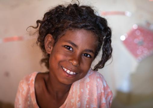 Portrait of a smiling Beja tribe girl, Red Sea State, Port Sudan, Sudan