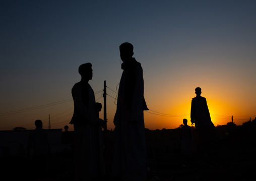 Silhouette people standing against sky during sunset, Kassala State, Kassala, Sudan