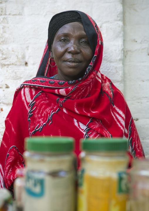 Sudan, Kassala State, Kassala, woman selling food at market