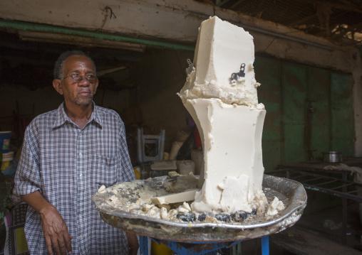 Sudan, Khartoum State, Omdurman, grease seller