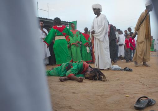 Sudan, Khartoum State, Khartoum, sufi dervish lying on the ground at omdurman sheikh hamad el nil tomb