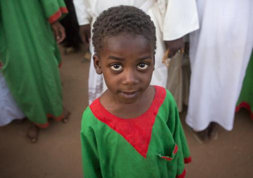 Sudan, Khartoum State, Khartoum, kid at sufi whirling dervishes at omdurman sheikh hamad el nil tomb, khartoum