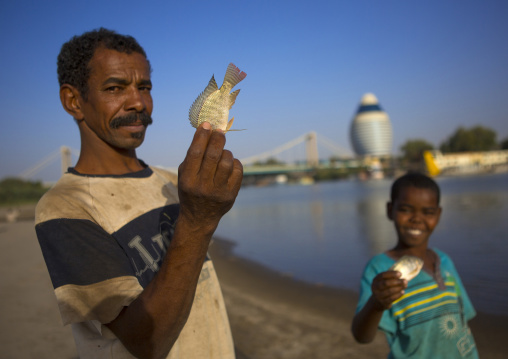Sudan, Khartoum State, Khartoum, fishermen on nile river bank