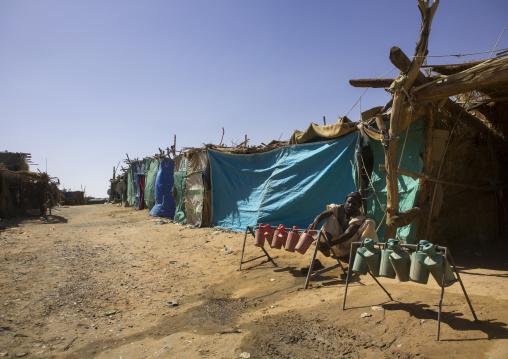 Sudan, Khartoum State, Alkhanag, man doing ablutions in the street