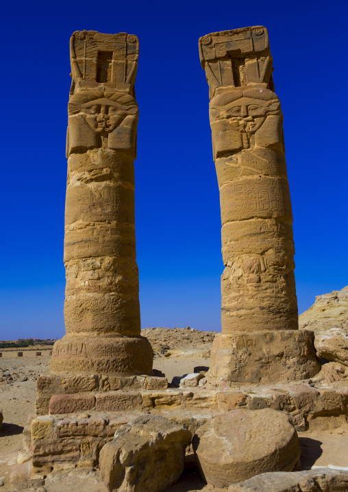Sudan, Northern Province, Karima, hatoric style columns in the outer courtyard of the temple of amun and mut at the base of the jebel barkal