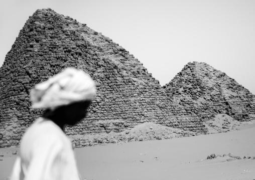 Sudan, Nubia, Nuri, sudanese man in front of the royal pyramids of napata
